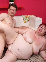 Naughty mature Margaret spread legged on the couch while a cock pounds her fat snatch